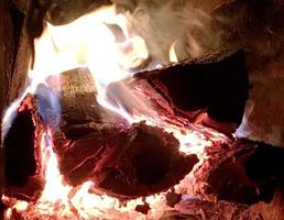 Beautiful red flame from slice wood photo