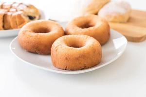 Doughnut on white plate photo