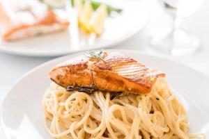 Spaghetti cream sauce with grilled salmon photo