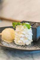 Charcoal toast with ice cream and whip cream photo