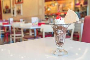 Chocolate sundae ice cream in cafe photo
