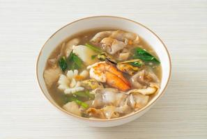 Wide Rice Noodles with Seafood in Gravy Sauce photo