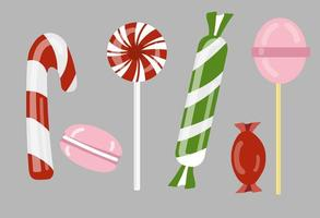 A set of lollipops, candies, and other sweets isolated on grey vector