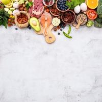 The concept of superfoods set up on white shabby concrete background photo