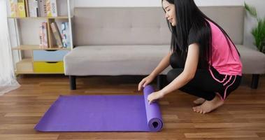 Woman Rolling up Yoga Mat video