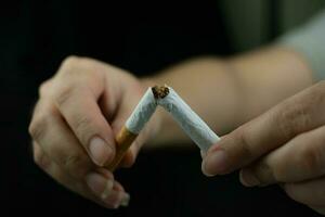 Women hand crushing cigarette photo