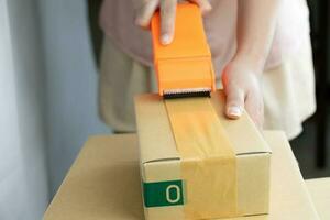 Women handle cutter adhesive tape sealing machine packing photo