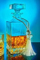 Square crystal decanter with scotch whiskey or brandy photo