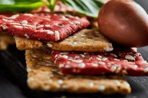 Beetroot and rye flour crackers with vegetables for making snack photo