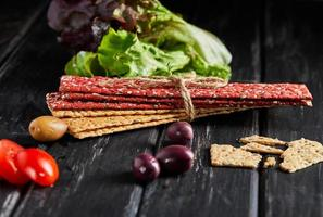 Beetroot and rye flour crackers with vegetables for making snacks photo