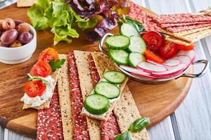Beetroot and rye flour crackers with vegetable photo