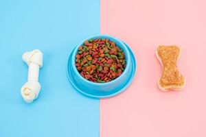 Pet food with snack bone for dog or cat on color background photo