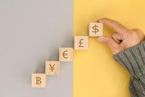 Business hand choose US dollar sign on wooden cube photo