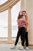 Young loving couple embracing each other outdoors in the park photo