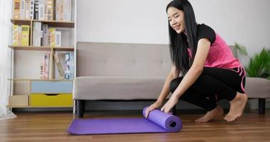 Woman Rolling up Their Yoga Mat video