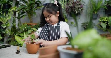 Girl Checking Potted Soil video