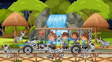 Safari en escena nocturna con niños viendo grupo de cebras. vector