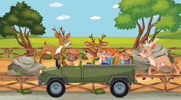Children group at the zoo with many deers vector