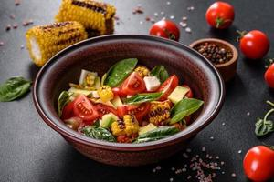 Delicious fresh salad with tomatoes, avocado photo