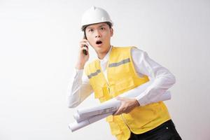 Portrait of male construction engineer with expression photo