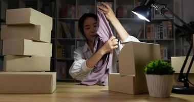 Woman Pack a Product to Box video