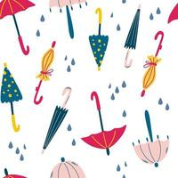 Seamless pattern with umbrellas and raindrops. vector