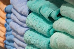 A stack of bath towels close-up. Spa accessories for health care. photo