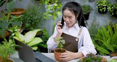 Gardener Has a Conversation Over a Smart Phone video