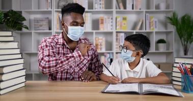 Young Man Teaching a Boy During Quarantine video