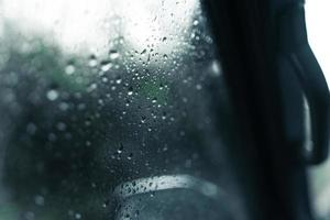 water droplets on car windshield on rainy day photo