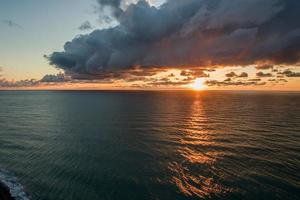Aerial view of the sea landscape with a beautiful sunset photo
