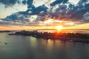 Vladivostok, Russia. Aerial view of the cityscape at sunset. photo