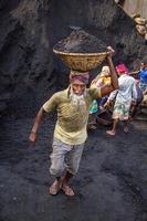 Amen Bazar, Dhaka, Bangladesh, 2018 - Men and women working hard for earning money. photo