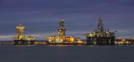 three oil drilling platform at night in Canary Islands photo