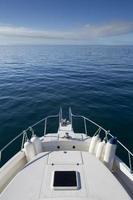 Blue sea and sky boat sailing photo
