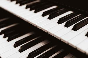 Close focus on upper row of piano keyboard in black and white. photo