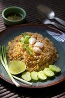 Crab meat fried rice on ceramic dish set on table. photo