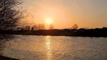 Sunset over the river. Rapid flow of water. video