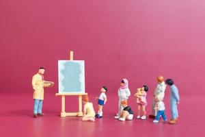 Miniature people art painting class with school children photo