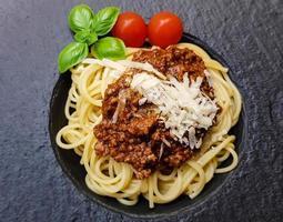 Spaghetti Bolognese with tomato sauce photo