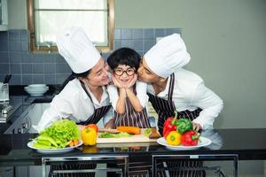 Asian woman young mother with son boy cooking photo
