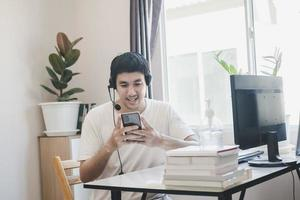 Asian man administrator staff call center in home service office photo