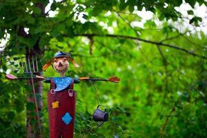 Farm Life Scarecrow in Green Nature photo