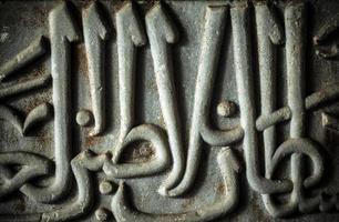 Epígrafe de edad antigua histórica en piedra de tableta de mármol foto