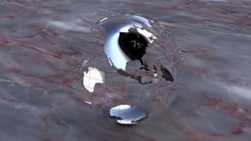 een chromen earth globe draait op een marmeren achtergrond - loop video