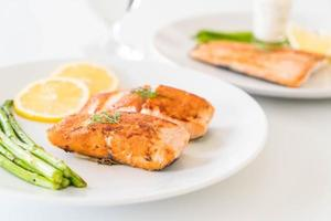 Grilled salmon steak on the table photo