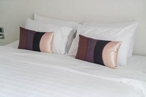 Pillow on bed decoration in bedroom interior photo