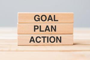 Wooden block with GOAL, PLAN and ACTION photo