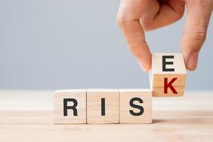 Flipping wooden blocks with RISK change to RISE photo