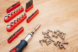 Working tools on wooden background. top view photo